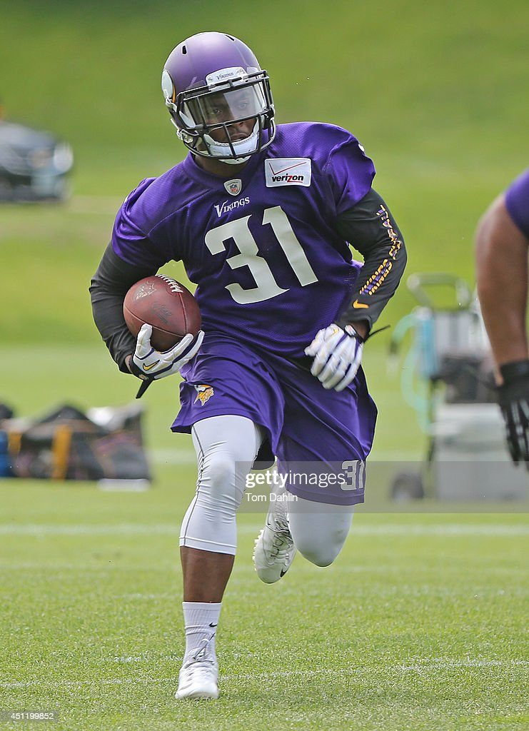 <a gi-track='captionPersonalityLinkClicked' href=/galleries/search?phrase=Jerick+McKinnon&family=editorial&specificpeople=9989195 ng-click='$event.stopPropagation()'>Jerick McKinnon</a> #31 of the Minnesota Vikings works out during Minicamp sessions at the Winter Park training facility on June 18, 2014 in Eden Prairie, Minnesota.