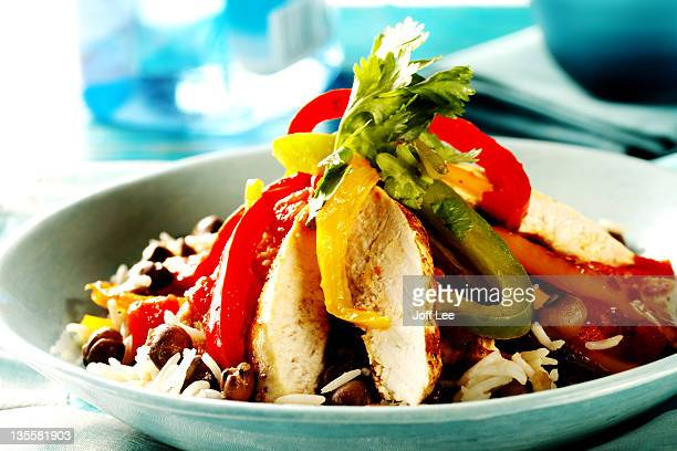 Jerk Chicken with fresh pepper and rice in dish