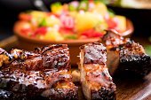 Jerk Pork belly with a mango salsa in the background