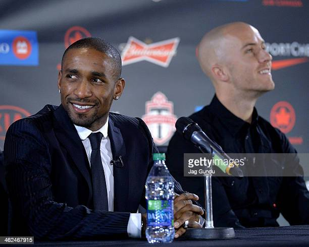 Jermain Defoe and Michael Bradley attend a press conference where they were introduced by Toronto FC at Real Sports Bar Grill on January 13 2014 in...