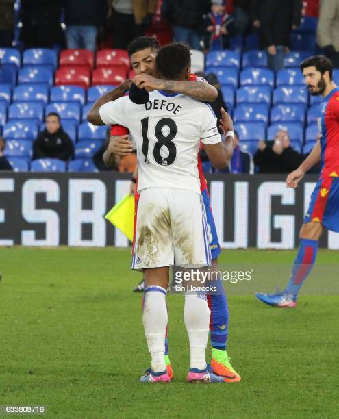 Jermain Defoe and Patrick Van Aanholt embrace on the final whistle during the Premier League match between Crystal Palace and Sunderland at Selhurst...