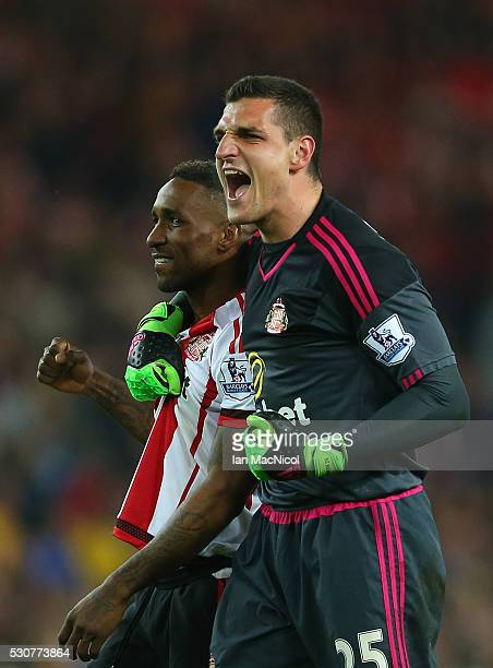 Jermain Defoe and Vito Mannone of Sunderland celebrate staying in the Premier League after the Barclays Premier League match between Sunderland and...