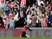 Jermain Defoe celebrates the opening goal on the ground during the Barclays Premier League match between Sunderland AFC and Newcastle United at the...