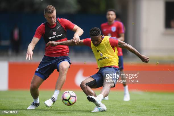 Jermain Defoe in action with Ben Gibson during the England training session at Stade Omnisports on June 11 2017 in Paris France