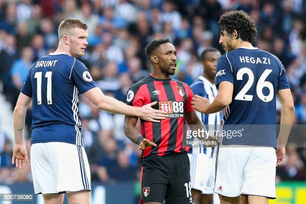 Jermain Defoe of AFC Bournemouth confronts Chris Brunt and Ahmed ElSayed Hegazi of West Bromwich Albion during the Premier League match between West...