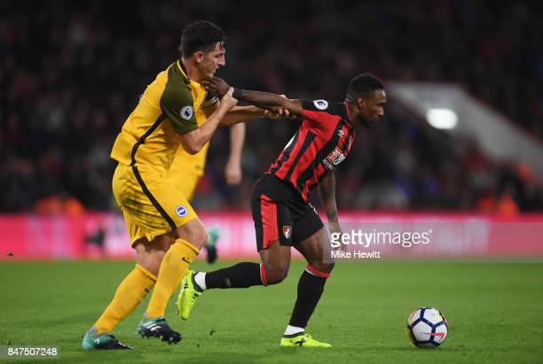 Jermain Defoe of AFC Bournemouth holds off Lewis Dunk of Brighton and Hove Albion during the Premier League match between AFC Bournemouth and...