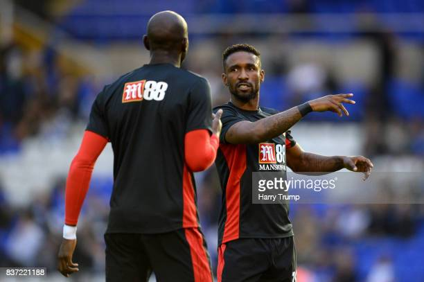 Jermain Defoe of AFC Bournemouth speaks to Benik Afobe of AFC Bournemouth prior to the Carabao Cup Second Round match between Birmingham City and AFC...