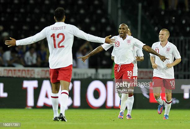 Jermain Defoe of England celebrates with Joleon Lescott after scoring their second goal during the international friendly match between England and...
