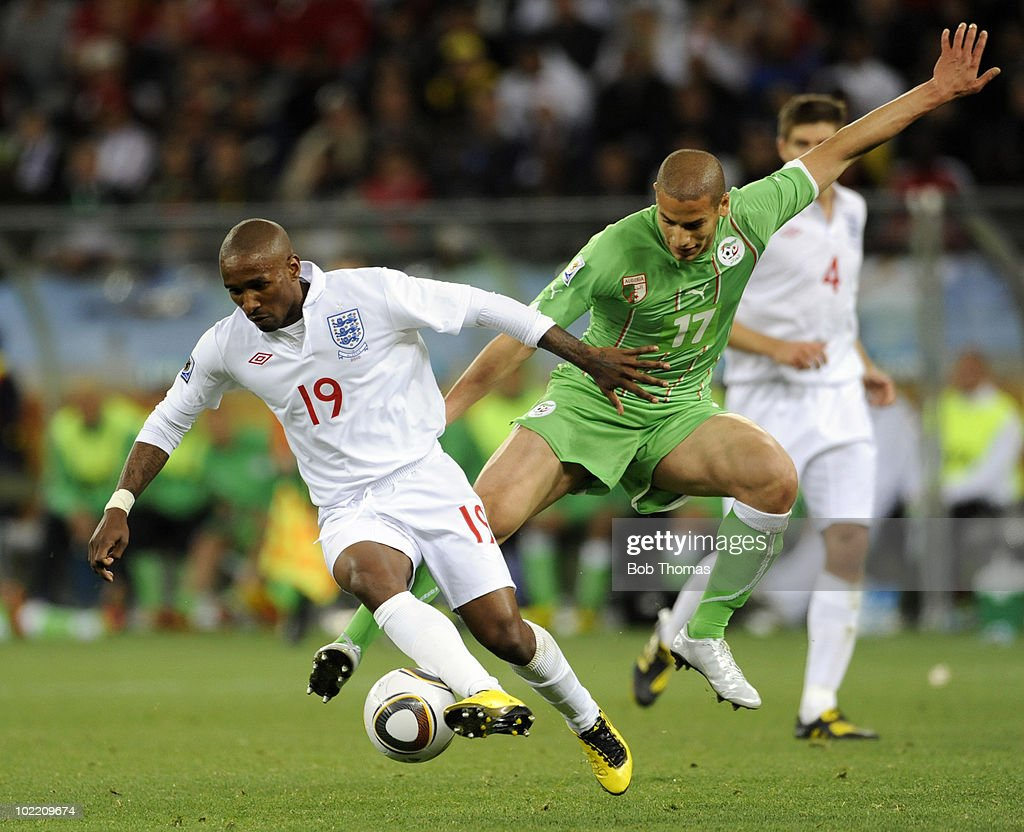<a gi-track='captionPersonalityLinkClicked' href=/galleries/search?phrase=Jermain+Defoe&family=editorial&specificpeople=171106 ng-click='$event.stopPropagation()'>Jermain Defoe</a> of England challenged by Adlane Guedioura of Algeria during the 2010 FIFA World Cup South Africa Group C match between England and Algeria at Green Point Stadium on June 18, 2010 in Cape Town, South Africa. The match was drawn 0-0.