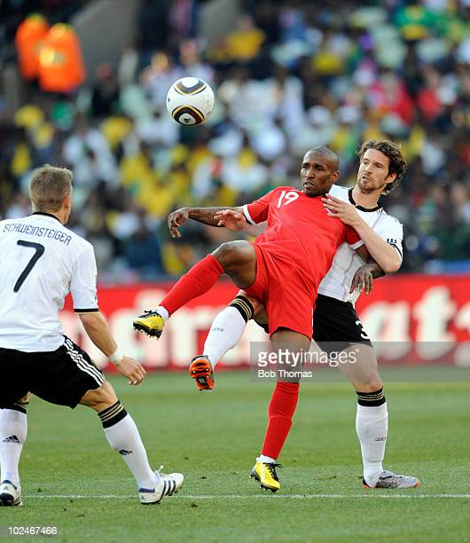 Jermain Defoe of England is challenged by Arne Friedrick of Germany during the 2010 FIFA World Cup South Africa Round of Sixteen match between...