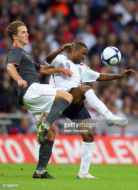 Jermain Defoe of England is challenged by Michael Bradley of USA during the international friendly match between England and the USA at Wembley...