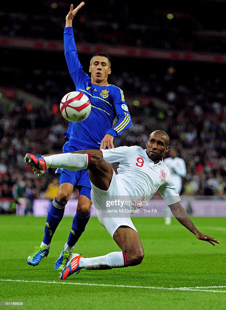 <a gi-track='captionPersonalityLinkClicked' href=/galleries/search?phrase=Jermain+Defoe&family=editorial&specificpeople=171106 ng-click='$event.stopPropagation()'>Jermain Defoe</a> of England tries to keep the ball in watched by Yevgen Khacheridi of Ukraine during the FIFA 2014 World Cup qualifier group H match between England and Ukraine at Wembley Stadium on September 11, 2012 in London, England.