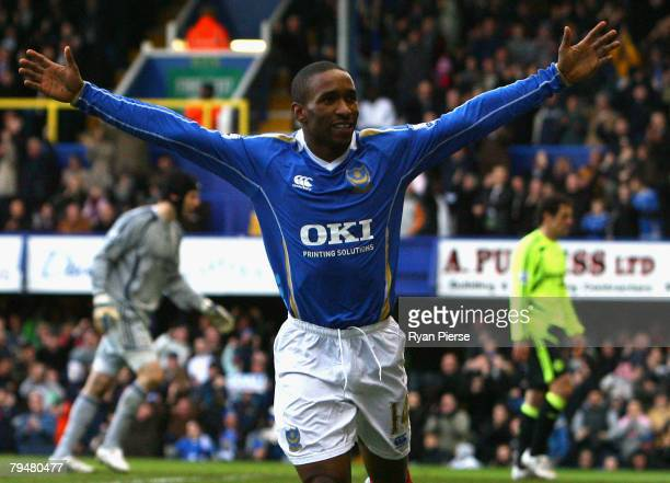 Jermain Defoe of Portsmouth celebrates after scoring his teams first goal during the Barclays Premier League match between Portsmouth and Chelsea at...
