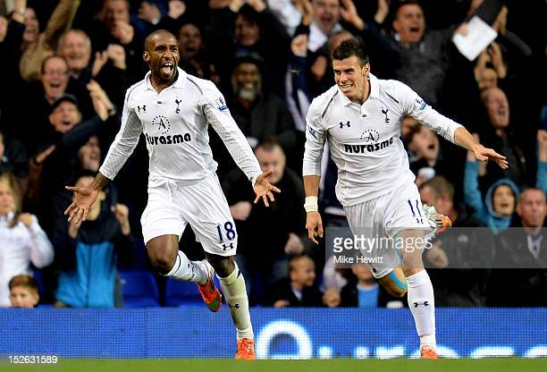 Jermain Defoe of Spurs celebrates with teammate Gareth Bale after scoring his team's second goal during the Barclays Premier League match between...