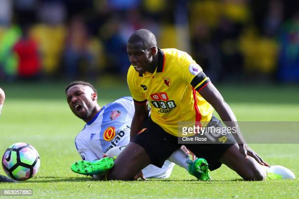 Jermain Defoe of Sunderland and Abdoulaye Doucoure of Watford colide during the Premier League match between Watford and Sunderland at Vicarage Road...