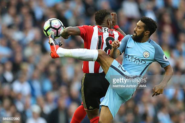 Jermain Defoe of Sunderland and Gael Clichy of Manchester City during the Premier League match between Manchester City and Sunderland at Etihad...