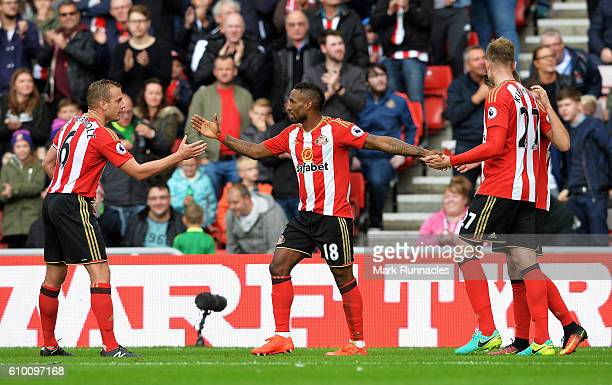 Jermain Defoe of Sunderland celebrates scoring his sides first goal with his team mates during the Premier League match between Sunderland and...