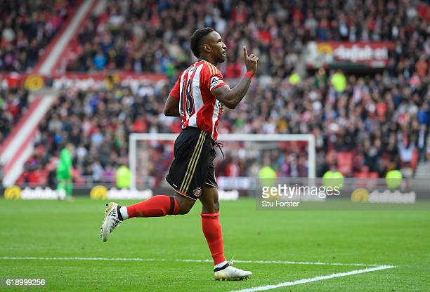 Jermain Defoe of Sunderland celebrates scoring his sides first goal during the Premier League match between Sunderland and Arsenal at the Stadium of...