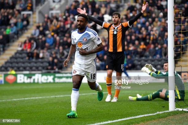 Jermain Defoe of Sunderland celebrates scoring his sides second goal as Andrea Ranocchia of Hull City appeals for offside during the Premier League...