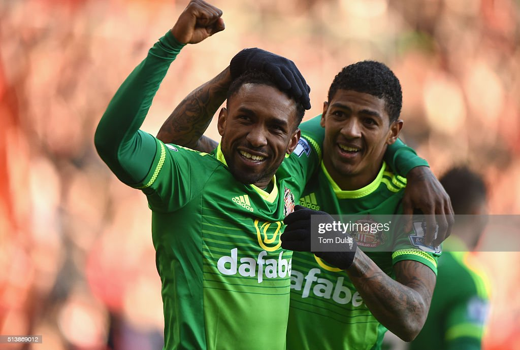 Jermain Defoe of Sunderland celebrates scoring his team's first goal with his team mate Patrick van Aanholt during the Barclays Premier League match...