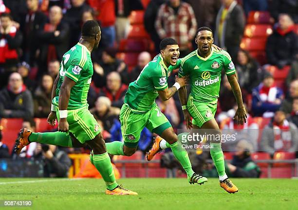 Jermain Defoe of Sunderland celebrates scoring his team's second goal with his team mates DeAndre Yedlin and Lamine Kone during the Barclays Premier...