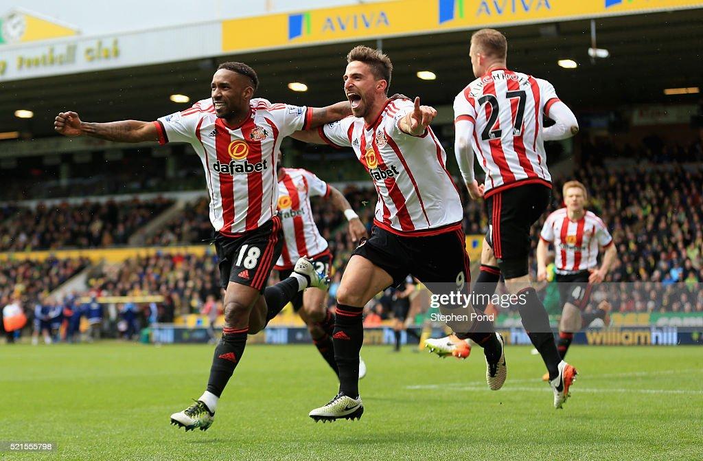 Jermain Defoe of Sunderland celebrates scoring his team's second goal with Fabio Borini during the Barclays Premier League match between Norwich City...