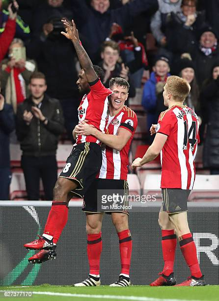 Jermain Defoe of Sunderland celebrates scoring his team's second goal with his team mates Billy Jones and Duncan Watmore during the Premier League...
