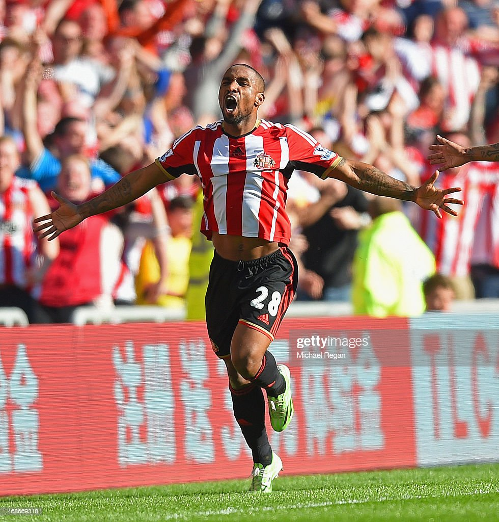 Jermain Defoe of Sunderland celebrates scoring the opening goal during the Barclays Premier League match between Sunderland and Newcastle United at...