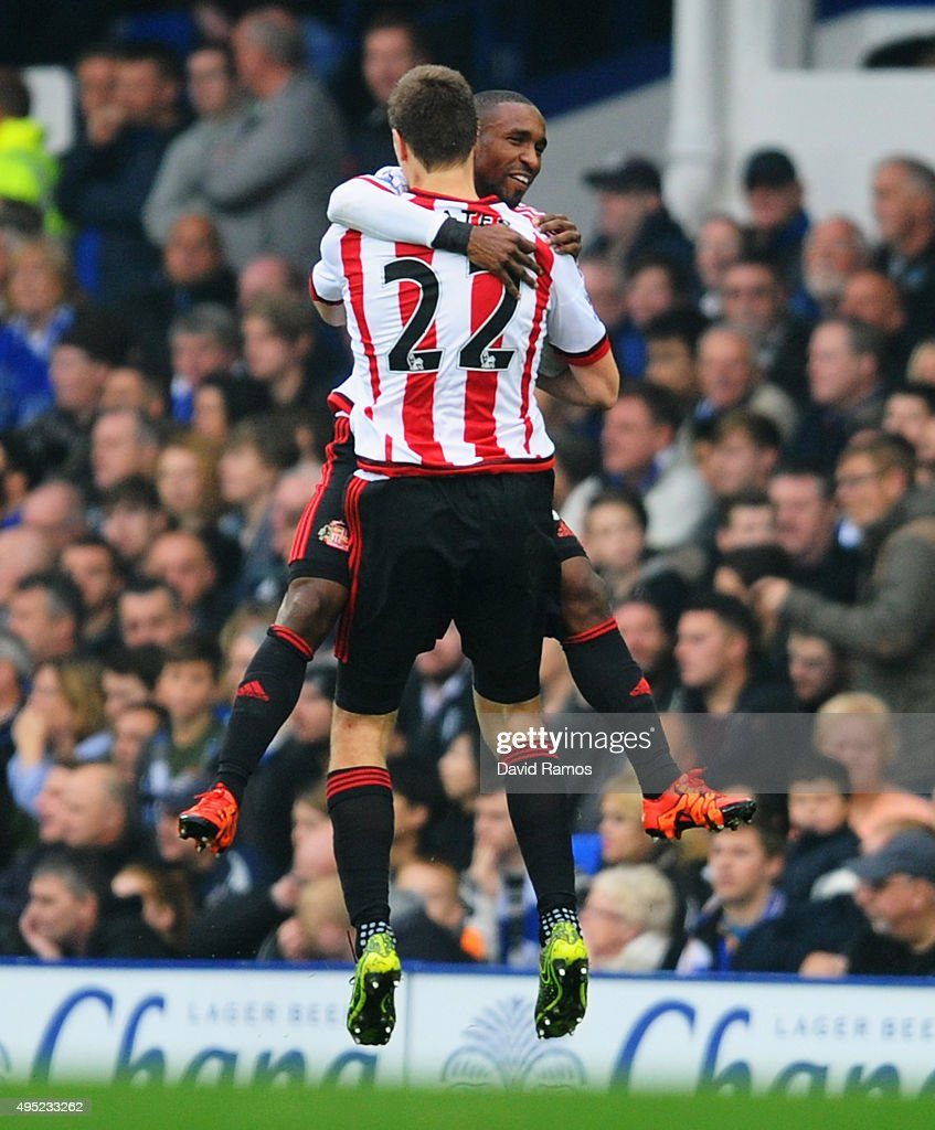 Jermain Defoe of Sunderland celebrates with team mate Sebastian Coates (22) as he scores their first goal during the Barclays Premier League match between Everton and Sunderland at Goodison Park on November 1, 2015 in Liverpool, England.