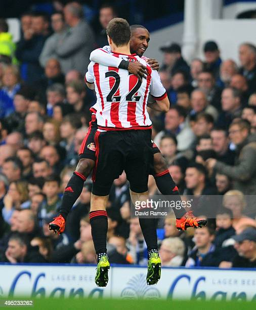 Jermain Defoe of Sunderland celebrates with team mate Sebastian Coates as he scores their first goal during the Barclays Premier League match between...
