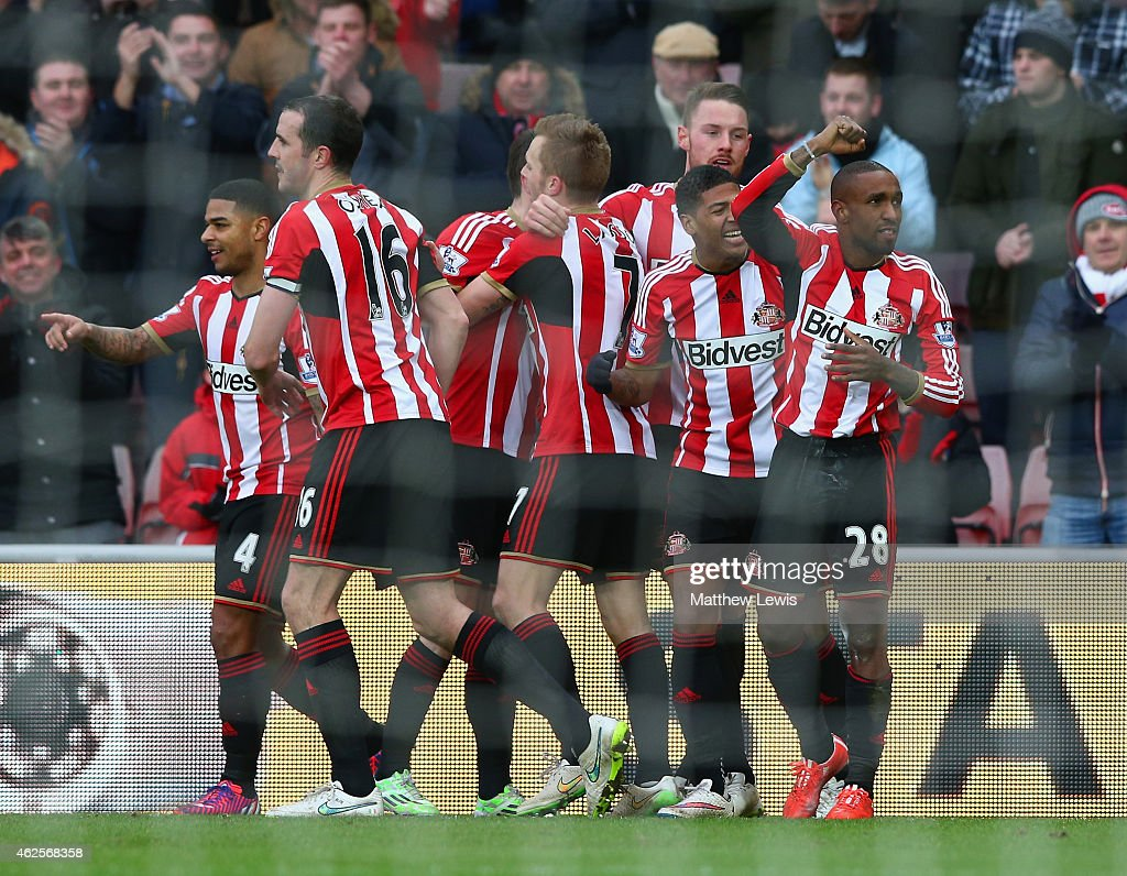Jermain Defoe of Sunderland celebrates with team mates after scoring their second goal during the Barclays Premier League match between Sunderland...