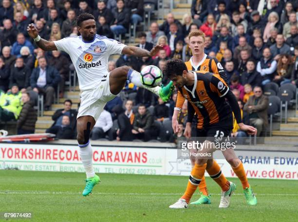Jermain Defoe of Sunderland challenges Andrea Ranocchia of Hull during the Premier League match between Hull City and Sunderland at KCOM Stadium on...
