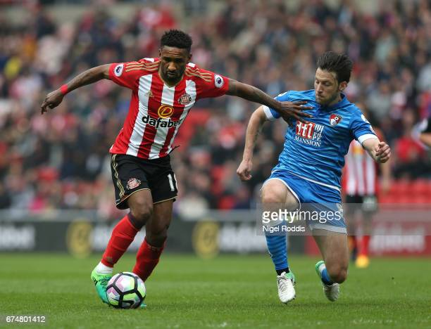 Jermain Defoe of Sunderland holds off Harry Arter of AFC Bournemouth during the Premier League match between Sunderland and AFC Bournemouth at the...