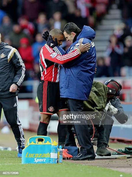 Jermain Defoe of Sunderland is congratulated by his manager Gus Poyet after being substituted during the Barclays Premier League match between...