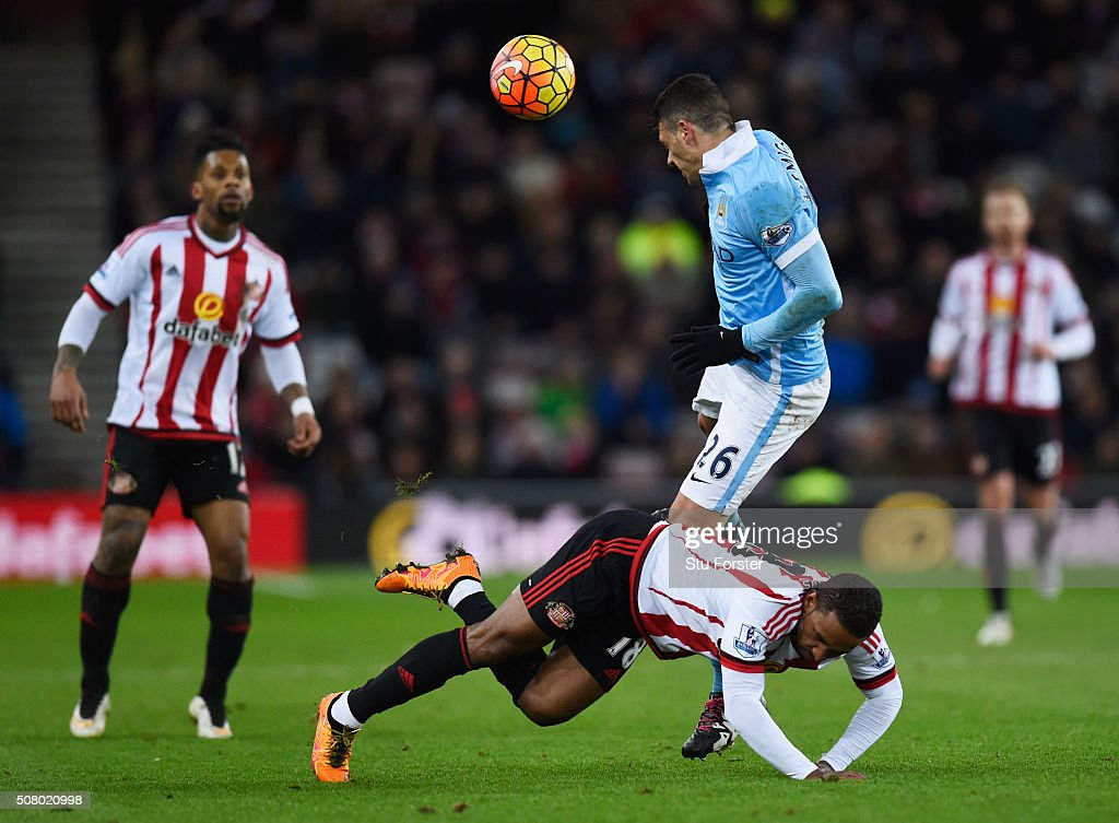 Jermain Defoe of Sunderland is fouled by Martin Demichelis of Manchester City during the Barclays Premier League match between Sunderland and Manchester City at the Stadium of Light on February 2, 2016 in Sunderland, England.