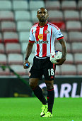 Jermain Defoe of Sunderland leaves the pitch with the match ball after scoring a hattrick during the Capital One Cup Second Round match between...