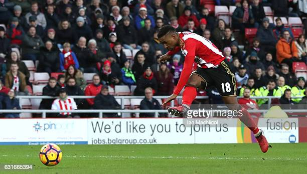 Jermain Defoe of Sunderland scores his sides first goal during the Premier League match between Sunderland and Stoke City at Stadium of Light on...