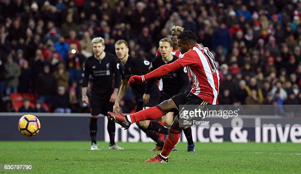 Jermain Defoe of Sunderland scores his sides second goal from the penalty spot during the Premier League match between Sunderland and Liverpool at...