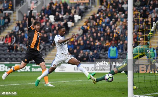 Jermain Defoe of Sunderland scores his sides second goal past Eldin Jakupovic of Hull City during the Premier League match between Hull City and...