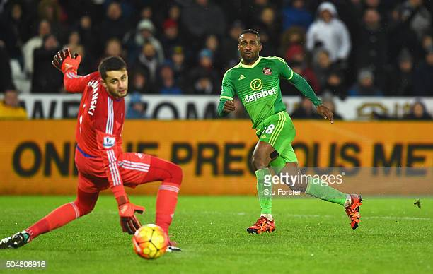 Jermain Defoe of Sunderland scores his team's third goal past Lukasz Fabianski of Swansea City during the Barclays Premier League match between...