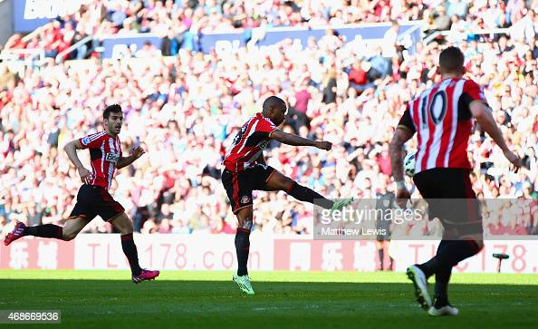 Jermain Defoe of Sunderland scores the opening goal during the Barclays Premier League match between Sunderland and Newcastle United at Stadium of...