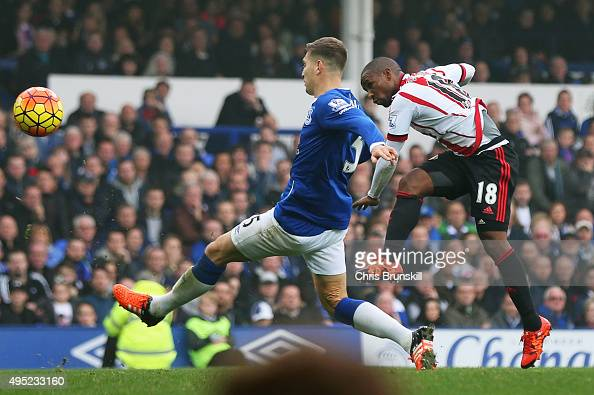 Jermain Defoe of Sunderland shoots past Phil Jagielka of Everton to score their first goal during the Barclays Premier League match between Everton...