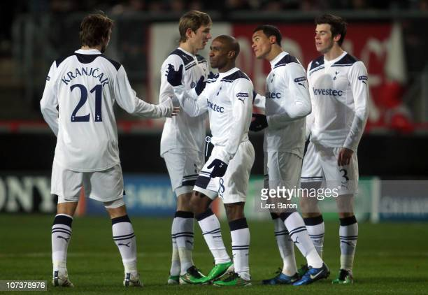 Jermain Defoe of Tottenham celebrates with team mates after the first goal during the UEFA Champions League Group A match between FC Twente and...