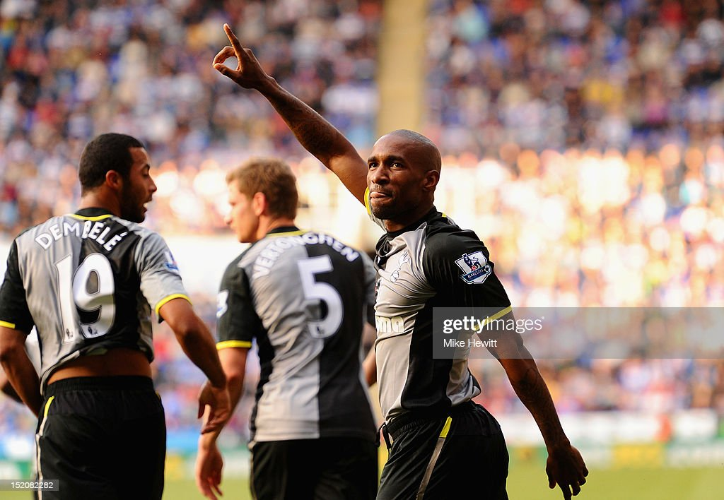 Jermain Defoe of Tottenham Hotspur celebrates his second goal during the Barclays Premier League match between Reading and Tottenham Hotspur at...
