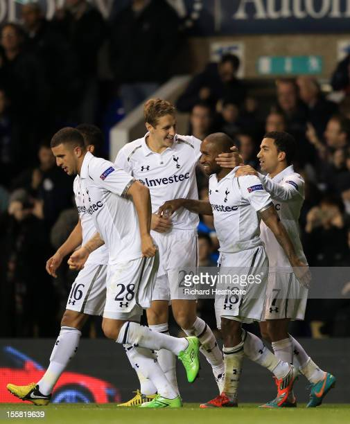 Jermain Defoe of Tottenham Hotspur celebrates scoring their second goal with Michael Dawson and Aaron Lennon of Tottenham Hotspur during the UEFA...