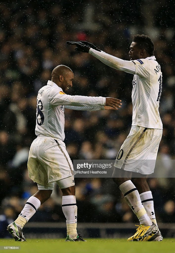 <a gi-track='captionPersonalityLinkClicked' href=/galleries/search?phrase=Jermain+Defoe&family=editorial&specificpeople=171106 ng-click='$event.stopPropagation()'>Jermain Defoe</a> of Tottenham Hotspur celebrates scoring their third goal with <a gi-track='captionPersonalityLinkClicked' href=/galleries/search?phrase=Emmanuel+Adebayor&family=editorial&specificpeople=484018 ng-click='$event.stopPropagation()'>Emmanuel Adebayor</a> of Tottenham Hotspur during the UEFA Europa League Group J match between Tottenham Hotspur and Panathinaikos at White Hart Lane on December 6, 2012 in London, England.