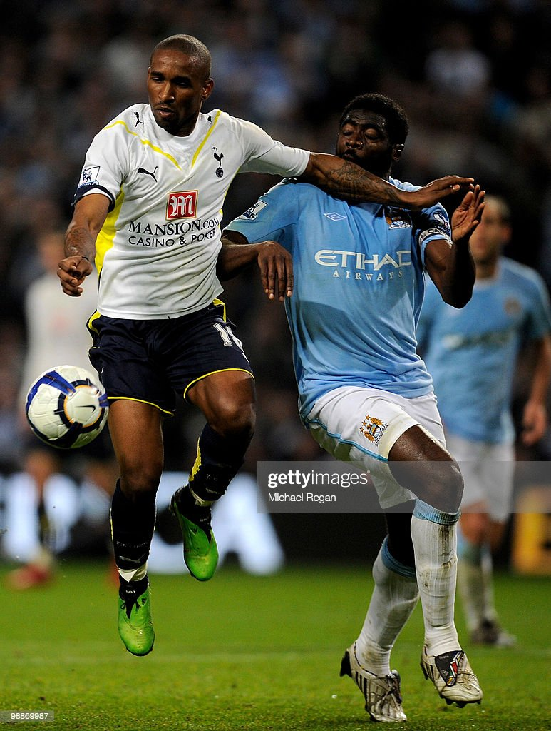 Jermain Defoe of Tottenham Hotspur holds off Kolo Toure of Manchester City during the Barclays Premier League match between Manchester City and Tottenham Hotspur at the City of Manchester Stadium on May 5, 2010 in Manchester, England.