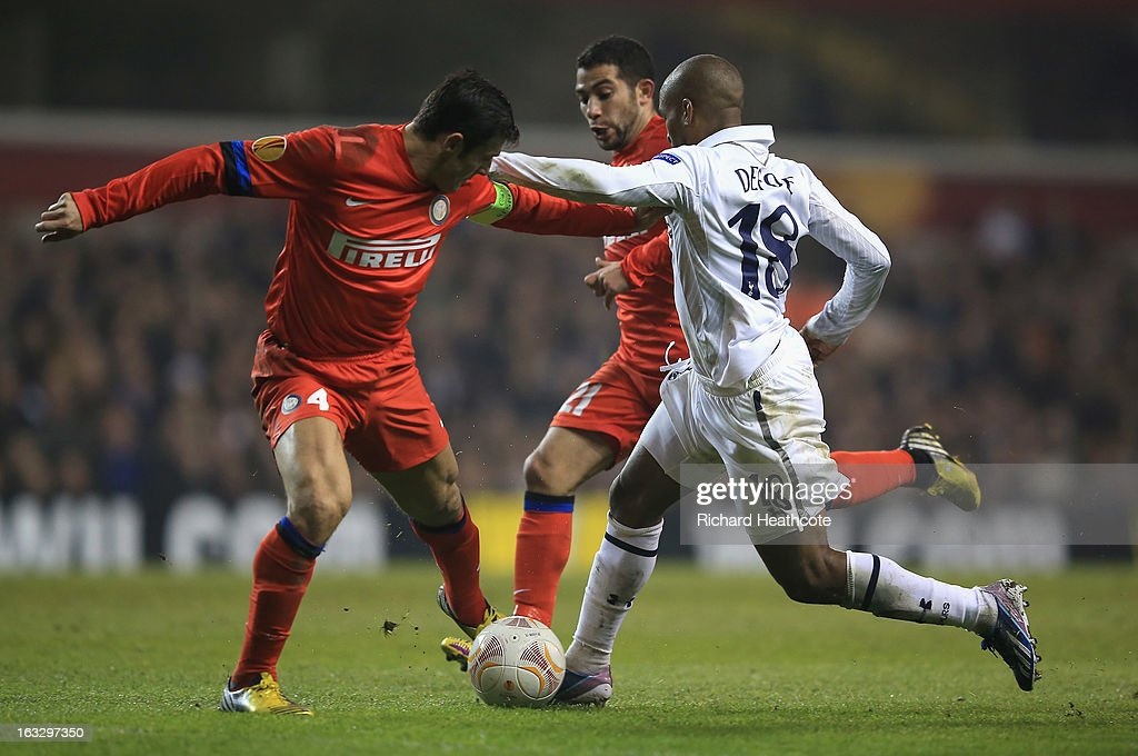 <a gi-track='captionPersonalityLinkClicked' href=/galleries/search?phrase=Jermain+Defoe&family=editorial&specificpeople=171106 ng-click='$event.stopPropagation()'>Jermain Defoe</a> of Tottenham Hotspur is tackled by <a gi-track='captionPersonalityLinkClicked' href=/galleries/search?phrase=Javier+Zanetti&family=editorial&specificpeople=206966 ng-click='$event.stopPropagation()'>Javier Zanetti</a> of FC Internazionale Milano during the UEFA Europa League Round of 16 First Leg match between Tottenham Hotspur and FC Internazionale Milano at White Hart Lane on March 7, 2013 in London, England.