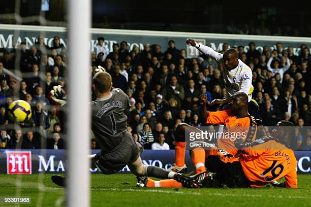 Jermain Defoe of Tottenham Hotspur scores his fourth goal during the Barclays Premier League match between Tottenham Hotspur and Wigan Athletic at...