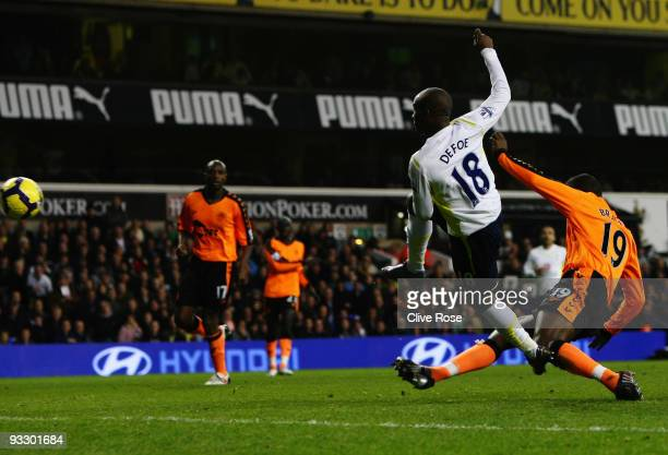 Jermain Defoe of Tottenham Hotspur scores their second goal during the Barclays Premier League match between Tottenham Hotspur and Wigan Athletic at...